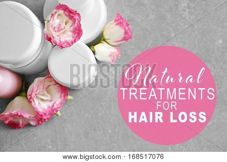 Text NATURAL TREATMENTS FOR HAIR LOSS and set of cosmetic products on gray background
