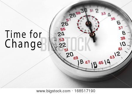 Stopwatch and text TIME FOR CHANGE on white background