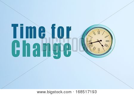 Text TIME FOR CHANGE and clock on blue wall background