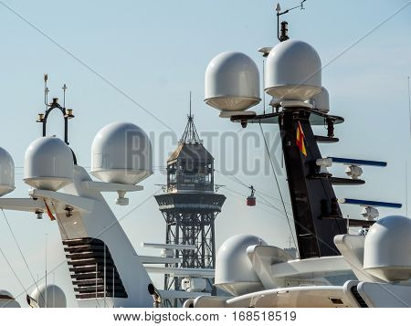 the cable car in the port of barcelona, spain. im foreground radar balls of yachts.
