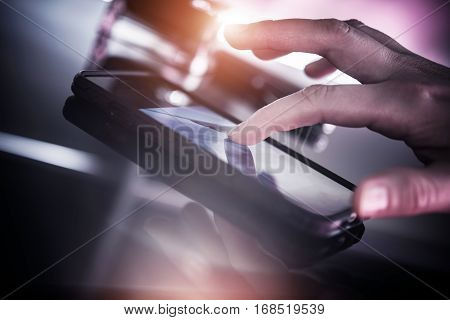Smartphone Mobile Device. Surfing the Internet on Smartphone. Female Hand Touching the Screen.