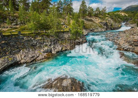 Wild Rushing Mountain River. Crystal Clear Waters of Norwegian River.