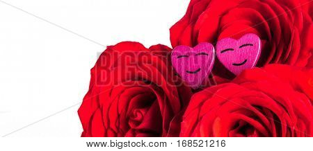 Roses and small smiling hearts isolated on white background
