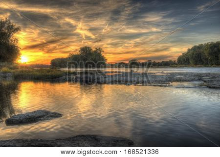 A beautiful Midwest Summer sunset on the Maumee River located in Grand Rapids, Ohio.