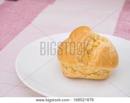 Cream Puff On White Dish, On Pink Tablecloth