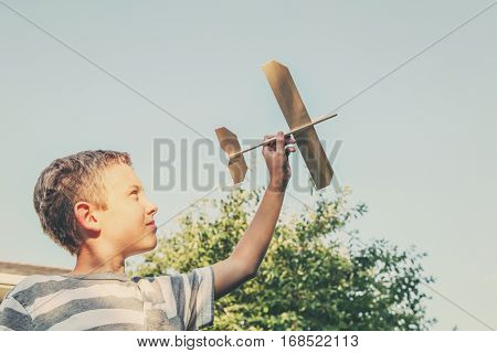 Boy flying a toy airplane in the sky
