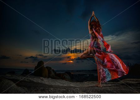 Young woman doing yoga Sun salutation Surya Namaskar, Tree Pose,
