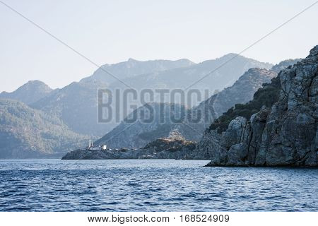 Coastal line of Marmaris with mediterranean aegen sea bay and mountains with pine trees forest