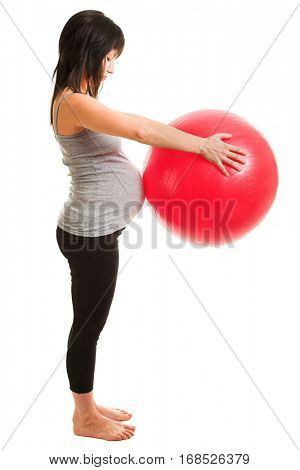 pregnant woman doing exercises with red gymnastic ball