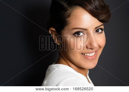 Beautiful young middle eastern woman smiling