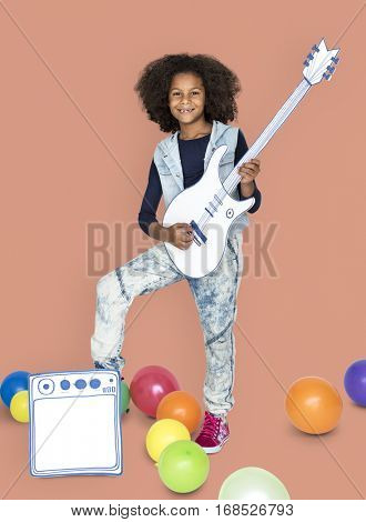 Portrait of a Little African Descent Girl with a Guitar Isolated