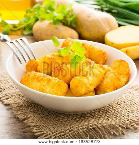 crunchy homemade potato croquettes served in a bowl.