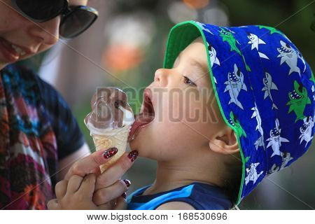 DIDIM TURKEY - JULY 9 2014. Casual portrait of a cute toddler with an ice cream cone.