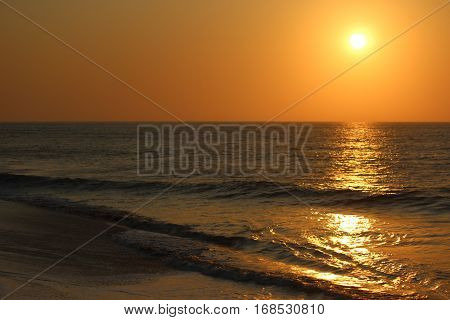 Sunset in the beCabo Ledo / Angola - May 2015: ach of Cabo Ledo in Angola