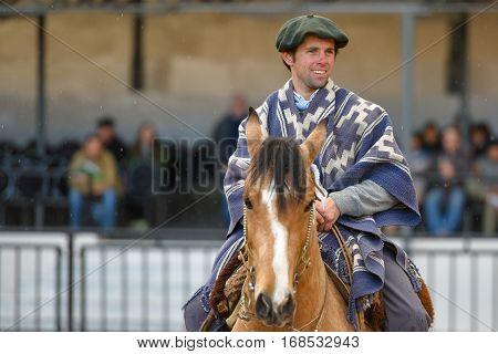 Gaucho Riding A Horse