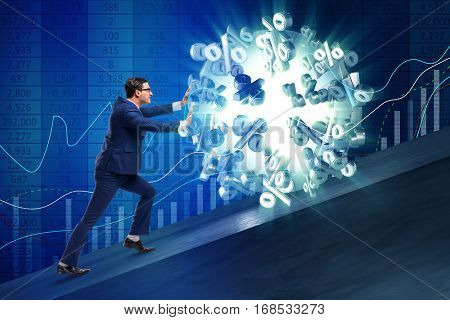 Businessman pushing away high interest rates
