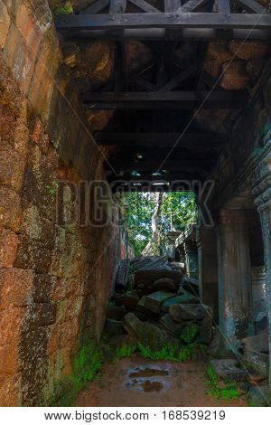 The gloomy passage in the interior of the ancient Preah Khan temple structures, Siem Reap, Cambodia
