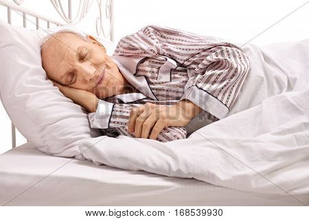 Senior sleeping in bed isolated on white background
