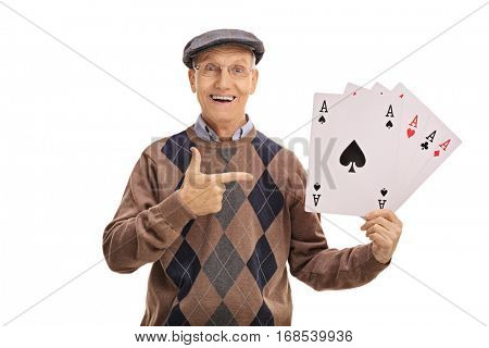 Cheerful senior holding four aces and pointing isolated on white background