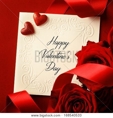 empty card, ribbon and rose petals - red heart on red background. Valentine's Day