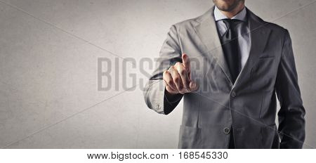 Businessman warning with his finger