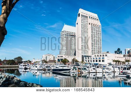 SAN DIEGO, CALIFORNIA - JANUARY 8, 2017:  Embarcadero Marina Park North near Seaport Village with surrounding hotels and city skyline.