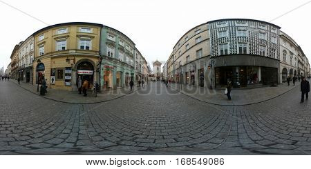 Krakow, Poland - December 22, 2016: People walking on the street in old town near Florian's gate