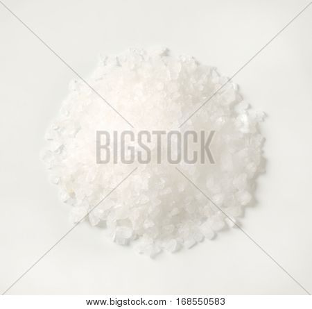 pile of coarse grained salt on white background