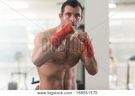 Portrait Of A With Red Boxing Gloves