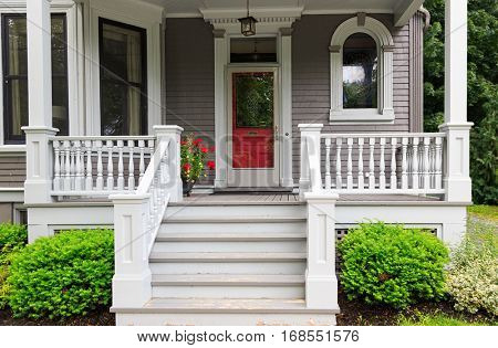 The front porch of a traditional older home. poster