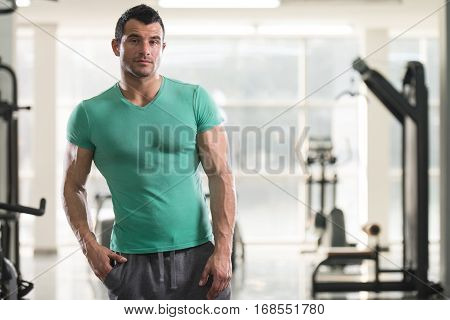 Strong Man In Green T-shirt Background Gym
