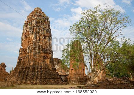 Ruins of prang of the temple complex of Wat Mahathat on a Sunny morning. Ayutthaya, Thailand