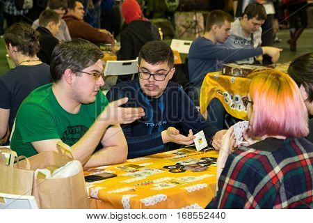 Moscow, Russia - November 20, 2016: People playing table game at the Gamefilmexpo festival dedicated to video games, TV series and comics, anime, manga, cosplay.
