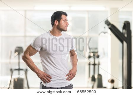 Strong Man In White T-shirt Background Gym