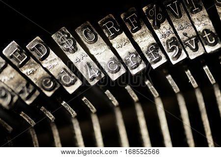 Old vintage typewriter keys and characters