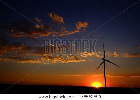 Power generated by wind with winmill blowing sky clouds sunset sunrise