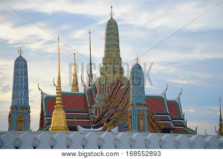 Prangs of Temple of the Emerald Buddha against the background of the evening sky. Royal palace of Bangkok, Thailand