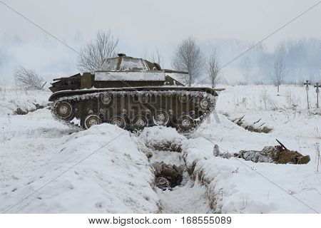 LENINGRAD REGION, RUSSIA - JANUARY 15, 2017: Soviet light tank T-70 in position. Fragment of military-historical reconstruction of the fighting for the breakthrough of the blockade of Leningrad in the great Patriotic war