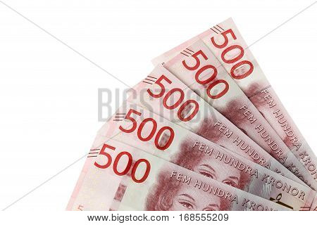 Close up of faned out Swedish currency SEK 500 banknotes introduced during the autumn 2016 located in the right bottom corner on white background.