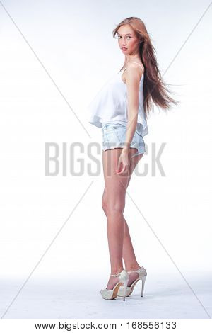 Young Woman In Blue Short