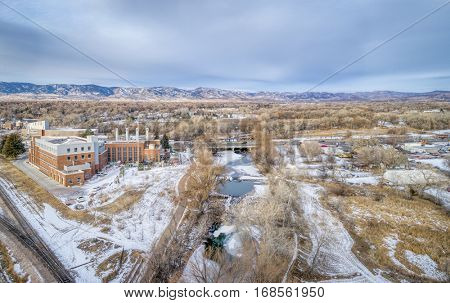 aerial cityscape of Fort Collins, Colorado, with Poudre River and  historic Municipal Power Plant, winter scenery