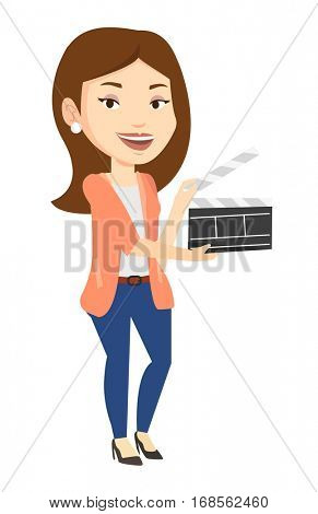 Happy caucasian woman working with a clapperboard. Smiling woman holding an open clapperboard. Woman holding blank movie clapperboard. Vector flat design illustration isolated on white background.