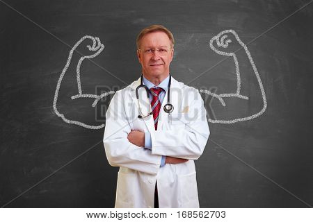 Strong successful doctor concept with muscles made with chalk on blackboard
