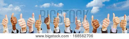 Business team group outside with thumbs up as success concept