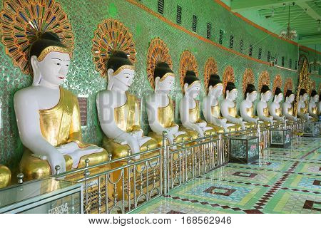 SAGAING, MYANMAR - DECEMBER 20, 2016: Gallery of statues of sitting Buddhas cave pagoda U Min Thonze Temple