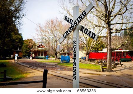 Rail road crossing sign in the country setting