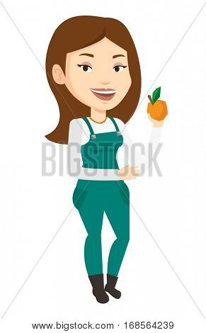 Happy caucasian female farmer holding an orange. Young smiling female farmer collecting oranges. Female gardener showing ripe orange. Vector flat design illustration isolated on white background.