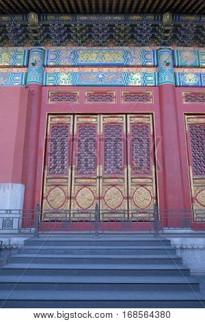 BEIJING - FEBRUARY 23:  An ornate painted door on a building in the Forbidden City in Beijing, China, February 23, 2016.