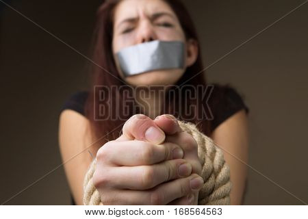 Brunette gagged and tied hands