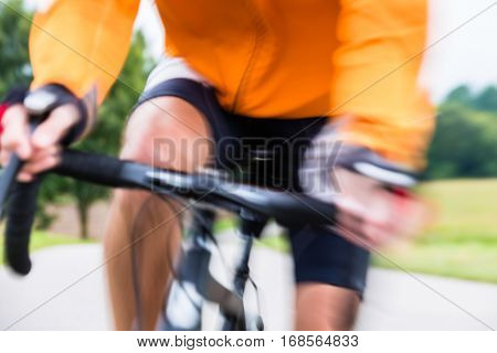 Fast Sport Bicyclist on bike with motion blur